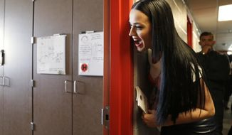 Singer Katy Perry canvasses for Democratic presidential nominee Hillary Clinton in a dorm at University of Nevada, Las Vegas, Saturday, Oct. 22, 2016, in Las Vegas. (AP Photo/John Locher)