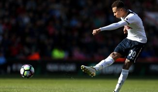 Tottenham Hotspur's Dele Alli takes a shot during the English Premier League soccer match between AFC Bournemouth and Tottenham Hotspur at the Vitality Stadium, Bournemouth, England, Saturday, Oct. 22, 2016. (Steve Paston/PA via AP)