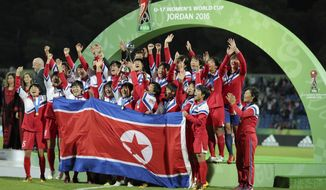 North Korea players celebrate after they won the final game of the FIFA U-17 Women's World Cup against Japan, at Amman International Stadium in Amman, Jordan, Friday, Oct. 21, 2016. The North Korean beat Japan in penalty kicks to win the 2016 FIFA U-17 Women's World Cup. North Korea defeated Japan 5:4 in a penalty shootout.(AP Photo/Raad Adayleh)