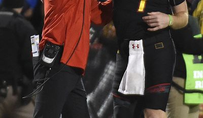 Maryland head coach DJ Durkin and quarterback Caleb Rowe celebrate a touchdown against Michigan State in the first half of an NCAA college football game, Saturday, Oct. 22, 2016, in College Park, Md. (AP Photo/Gail Burton)