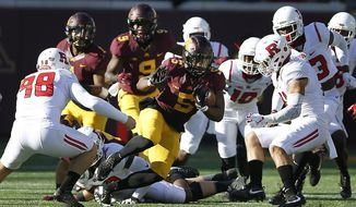 Minnesota wide receiver Melvin Holland Jr. breaks through Rutgers defense during the first half of an NCAA college football game Saturday, Oct. 22, 2016, in Minneapolis. (AP Photo/Stacy Bengs)