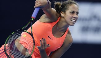 FILE - In this Oct. 7, 2016 file photo, Madison Keys of the United States serves against Petra Kvitova of the Czech Republic during the women's singles quarterfinals of the China Open tennis tournament in Beijing.  Keys is the first American outside of Serena and Venus Williams to earn a berth at the year-end WTA Finals in more than a decade. (AP Photo/Andy Wong)