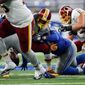 Washington Redskins running back Matt Jones fumbled twice on Sunday, including one at the Detroit Lions' 7-yard line. (Associated Press)