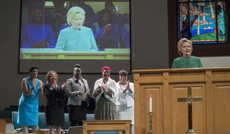 Democratic presidential candidate Hillary Clinton is joined by mothers of black men who died from gun violence, Geneva Reed-Veal, left, mother of Sandra Bland, Lucia McBath, second from left, mother of Jordan Davis, Sybrina Fulton, center, mother of Trayvon Martin, Maria Hamilton, second from right, mother of Dontre Hamilton, and Gwen Carr, mother of Eric Garner as she speaks during Sunday service at Union Baptist church, Sunday, Oct. 23, 2016, in Durham, N.C. (AP Photo/Mary Altaffer)