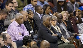 Former NBA player Julius Erving, left, in stripes, and Georgetown men's basketball coach John Thompson III, center listen to former Philadelphia 76er Allen Iverson during a news conference Wednesday, Oct. 30, 2013, in Philadelphia. Iverson officially retired from the NBA, ending a 15-year career during which he won the 2001 MVP award and four scoring titles. Iverson retired in Philadelphia where he had his greatest successes and led the franchise to the 2001 NBA finals. (AP Photo/Matt Rourke) **FILE**