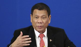 In this Thursday, Oct. 20, 2016, file photo, Philippine President Rodrigo Duterte delivers a speech during the Philippines-China Trade and Investment Forum at the Great Hall of the People in Beijing. (Wu Hong/Pool Photo via AP, File)