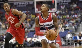 Washington Wizards guard Bradley Beal (3) controls the ball against Toronto Raptors guard DeMar DeRozan (10) during the second half of an NBA preseason basketball game, Friday, Oct. 21, 2016, in Washington. The Wizards won 119-82. (AP Photo/Nick Wass)