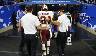 Washington Redskins cornerback Josh Norman is helped off the field during the second half of an NFL football game against the Detroit Lions, Sunday, Oct. 23, 2016 in Detroit. (AP Photo/Paul Sancya)