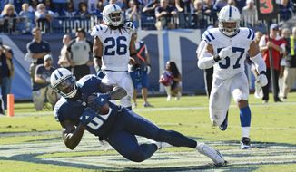 Tennessee Titans tight end Delanie Walker (82) catches a 7-yard touchdown pass ahead of Indianapolis Colts defenders Clayton Geathers (26) and Josh McNary (57) in the second half of an NFL football game Sunday, Oct. 23, 2016, in Nashville, Tenn. (AP Photo/Mark Zaleski)