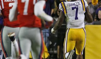 LSU running back Leonard Fournette (7) looks back as he runs into the end zone for a touchdown during the first half an NCAA college football game against Mississippi in Baton Rouge, La., Saturday, Oct. 22, 2016. (AP Photo/Max Becherer)