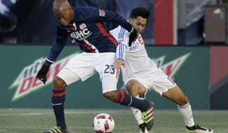 New England Revolution defender Jose Goncalves (23) and Montreal Impact forward David Choiniere (17) vie for control of the ball during the first half of an MLS soccer game, Sunday, Oct. 23, 2016, in Foxborough, Mass. (AP Photo/Steven Senne)