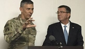 Army Lt. Gen. Stephen Townsend, the top U.S. Commander in Iraq, and Defense Secretary Ash Carter brief reporters in Irbil, Iraq, Sunday, Oct. 23, 2016 on the battle to retake Mosul from Islamic State militants. Carter visited the area for a closer look at the fight against the Islamic State group and to hear from Kurdish leaders. (AP Photo/Lolita Balder)