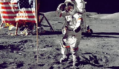"""Eugene A. Cernan, Commander, Apollo 17 salutes the flag on the lunar surface during extravehicular activity (EVA) on NASA's final lunar landing mission. The Lunar Module """"Challenger"""" is in the left background behind the flag and the Lunar Roving Vehicle (LRV) also in background behind him. While astronauts Cernan and Schmitt descended in the Challenger to explore the Taurus-Littrow region of the Moon, astronaut Ronald E. Evans, Command Module pilot, remained with the Command/Service Module (CSM) """"America"""" in lunar-orbit."""