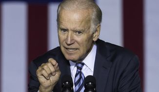 Vice President Joe Biden campaigns for Democratic presidential candidate Hillary Clinton at the Sinclair Community College Automotive Technology Building, Monday, Oct. 24, 2016, in Dayton, Ohio. (AP Photo/John Minchillo)