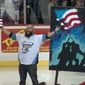 Artist and singer Joe Everson painted a depiction of the iconic 1945 Iwo Jima photograph while he sang the national anthem at Saturday's Toledo Walleye game. (YouTube/@Toledo Walleye)