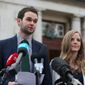 Daniel and Amy McArthur of Ashers Baking Co. speak to the media at Belfast High Court, Northern Ireland, as judgment is due to be delivered on an appeal brought by the Christian bakers who were found to have discriminated against gay man Gareth Lee, Monday, Oct. 24, 2016. (Niall Carson/PA via AP)