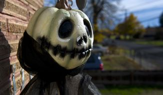 Part of the Halloween decorations hangs at a home in Walla Walla, Wash., Monday, Oct. 24, 2016. (Michael Lopez/Walla Walla Union-Bulletin via AP)