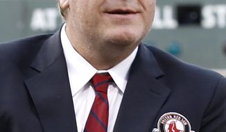 FILE - In this Aug. 3, 2012, file photo, former Boston Red Sox pitcher Curt Schilling looks on after being introduced as a new member of the Boston Red Sox Hall of Fame before a baseball game between the Red Sox and the Minnesota Twins at Fenway Park in Boston. Schilling is joining the Breitbart News Network as host of the conservative organization's first online radio show beginning Tuesday at 9 a.m. ET. (AP Photo/Winslow Townson, File)