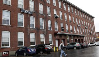 This photo shows Dyn, a New Hampshire internet service company, in the old mill section of the city, Friday Oct. 21, 2016 in Manchester, N.H. Cyberattacks on a key internet firm repeatedly disrupted the availability of popular websites across the United States Friday, according to analysts and company officials. The White House described the disruption as malicious.  (AP Photo/Jim Cole)