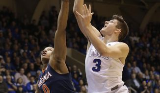 FILE - In this Feb. 13, 2016, file photo, Duke's Grayson Allen (3) drives to the basket as Virginia's Devon Hall (0) defends during the second half of an NCAA college basketball game in Durham, N.C. The parallels between this Duke team and the group from 2014-15 seem too obvious to ignore: A roster dominated by one-and-done freshmen led those Blue Devils to their fifth national title, and now a repeat of that year certainly appears possible _ maybe even likely. (AP Photo/Gerry Broome, File)