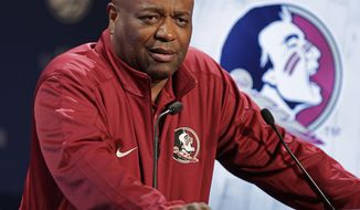 FILE - In this Oct. 28, 2015, file photo, Florida State NCAA college basketball coach Leonard Hamilton answers a question during the Atlantic Coast Conference men's media day in Charlotte, N.C. Hamilton is hoping a shift to a more up-tempo perimeter style will lead to the program's first NCAA Tournament berth since 2012. (AP Photo/Chuck Burton, File)