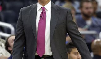In this Thursday, Oct. 20, 2016, photo, Orlando Magic head coach Frank Vogel directs his team against the New Orleans Pelicans during the second half of an NBA preseason basketball game in Orlando, Fla. Tipping off an NBA season isn't new to Vogel, yet this year is a different for the veteran coach. The always optimistic Vogel is preparing to begin a new era with the Magic after being unceremoniously dismissed by the Indiana Pacers. (AP Photo/John Raoux)