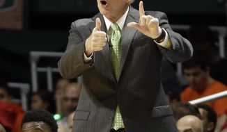 FILE- In this Dec. 8, 2015, file photo,  Miami head coach Jim Larranaga shouts instructions to his players during the first half of an NCAA basketball game against Florida, in Coral Gables, Fla. With a young team short on experience, Larranaga worries about the little things. The top two starters and top rebounder departed from last season's team, which went 27-8 and reached the third round of the NCAA Tournament. Larranaga has only 10 scholarship players, five of them newcomers. (AP Photo/Alan Diaz, File)