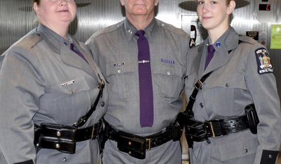 In this Oct. 12, 2016 photo provided by New York State Police Troop D, New York State Police Superintendent George Beach is flanked by Trooper Meagan Hartmann, right, and her mother, Bethany Lamphere in Albany, N.Y., on the day of Hartmann's graduation from the State Police Academy. The mother and daughter work as uniformed troopers at separate stations 60 miles apart in central New York. (New York State Police via AP)