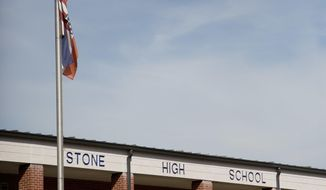 "Stone County High School in Wiggins, Miss., is seen Monday, Oct. 24, 2016. The state NAACP says white students at Stone County High School threw a noose around the neck of a black student and ""yanked backward"".  Ayana Kinnel, spokeswoman for the civil-rights group, says Monday that the incident took place the afternoon of Oct. 13 at the Stone County High School field house in Wiggins. The civil-rights group is calling on the school to expel the white students. (AP Photo/Max Becherer)"