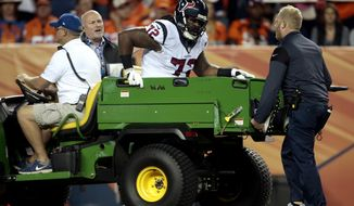 Houston Texans tackle Derek Newton (72) is helped off the field after an injury against the Denver Broncos during the first half of an NFL football game, Monday, Oct. 24, 2016, in Denver.(AP Photo/Joe Mahoney)