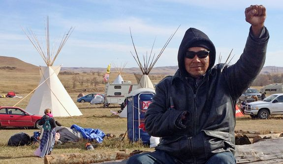 The dispute over the Dakota Access oil pipeline expanded off Indian reservations to private land purchased by the pipeline builders. (Associated Press)
