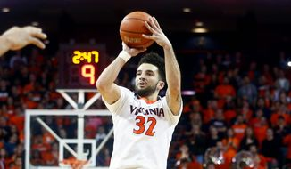 "Virginia guard London Perrantes gets ""a little knot inside my stomach"" when he thinks about last year's regional final loss. (Associated Press)"