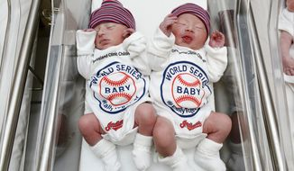 Unidentified babies wear World Series onesie at the Cleveland Clinic's Fairview Hospital in Cleveland on Tuesday, Oct. 25, 2016. Newborn babies at the Cleveland hospital have joined the ranks of the Cleveland Indians' fans. The clinic says babies born today and throughout the World Series at several of its hospitals will be dressed in the outfits to help cheer on the Indians' quest for a championship as they take on the Chicago Cubs. The first game of the series was set for Tuesday in Cleveland. (Cleveland Clinic via AP)