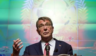 """""""We're seeking the lasting defeat of ISIL. And a lasting defeat of ISIL can't be achieved by outsiders. It can only be achieved by those who live there,"""" Defense Secretary Ashton Carter said. (Associated Press)"""