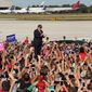 Donald Trump arrives at a Trump rally at Sanford Orlando International Airport in Sanford, Fla., Tuesday, Oct. 25, 2016. Trump is pledging to bolster the government's investment in the space program, a boon to the Space Coast of Florida. (Stephen M. Dowell/Orlando Sentinel via AP)