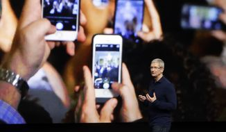 In this Wednesday, Sept. 7, 2016, file photo, Apple CEO Tim Cook announces the new iPhone 7 during an event to announce new products, in San Francisco. Apple reported Tuesday, Oct. 25, 2016, that it sold 45.5 million iPhones in the previous quarter, 5 percent fewer than it sold a year earlier. But the giant tech company's rosy forecast for the holidays was better than what Wall Street had been expecting. (AP Photo/Marcio Jose Sanchez, File) **FILE**