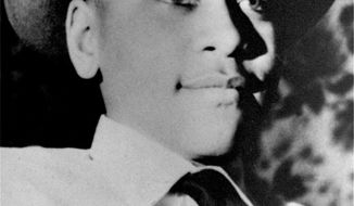 FILE - An undated portrait shows Emmett Till, a black 14-year-old Chicago boy, who was brutally murdered near Money, Mississippi, Aug. 31, 1955, after witnesses said he whistled at a white woman. The Emmett Till Interpretive Center, in glendora, Miss., dedicated to the memory Emmett Till, has raised over $20,000 to replace a bullet-riddled sign commemorating the 1955 Mississippi killing that helped propel the civil rights movement.  (AP Photo/File)