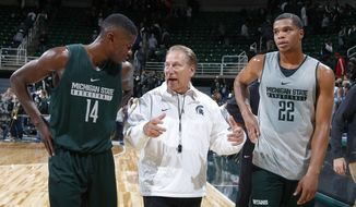FILE - In this Oct. 14, 2016, file photo, Michigan State coach Tom Izzo, center, talks with Eron Harris, left, and Miles Bridges following the NCAA college basketball team's scrimmage, in East Lansing, Mich. Bridges might be the best player Hall of Famer Tom Izzo has coached in two-plus decades at Michigan State. (AP Photo/Al Goldis, File)