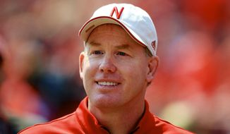 FILE - In this April 11, 2015 file photo, Nebraska Athletic Director Shawn Eichorst stands on the sidelines during a football game in Lincoln, Neb. The NCAA committee that crafted proposed football recruiting reforms, which includes the addition of early signing periods, wants to create more transparency and access for coaches and players in a process that has been accelerated in recent years, said a key member of the group. Eichorst told The Associated Press the football oversight committee created an interconnected and comprehensive package of reforms while acknowledging the new realities of recruiting. (AP Photo/Nati Harnik, File)
