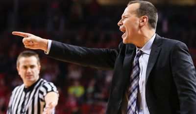 FILE - In this Dec. 20, 2015, file photo, Northwestern coach Chris Collins yells during an NCAA college basketball game against Nebraska in Lincoln, Neb. Collins appears to have the Wildcats headed in the right direction entering his fourth season. But the big question still lingers. When will Northwestern, the school that hosted the first Final Four in 1939, make the NCAA tournament? (AP Photo/Nati Harnik, File)