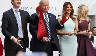 Republican candidate Donald Trump's atypical run at the White House may be harming the family's brands. Daughter Ivanka Trump's clothing line is facing a boycott, and Trump Hotels left the family name off a new brand. (Associated Press)