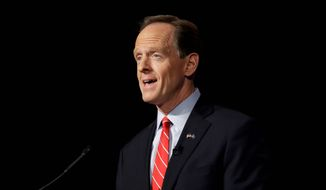 Republican Sen. Pat Toomey takes part in a Pennsylvania U.S. Senate debate with Democrat Katie McGinty at Temple University in Philadelphia, Monday, Oct. 24, 2016. (AP Photo/Matt Rourke) ** FILE **