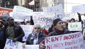 Protestors gather outside of New York Governor Andrew Cuomo's office on third avenue Wednesday, Oct. 26, 2016, in New York.  Tech leaders and hundreds of Airbnb hosts gathered outside Cuomo's office to rally for 'fair' home-sharing laws. (AP Photo/Frank Franklin II)