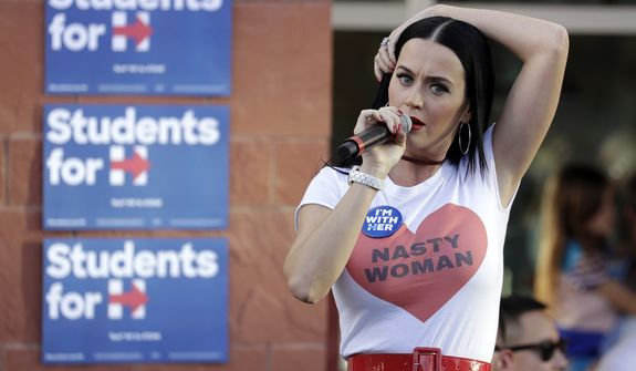 "Hillary Clinton backer and singer Katy Perry wore a ""nasty woman"" shirt when campaigning for the former first lady in Nevada earlier this week. (Associated Press)"