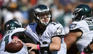 Philadelphia Eagles quarterback Carson Wentz throws to a receiver in the first half of an NFL football game against the Washington Redskins in Landover, Md., Oct. 16, 2016. (AP Photo/Nick Wass) ** FILE **