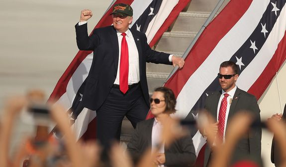 Donald Trump gestures following at a campaign rally Tuesday on the tarmac at Orlando Sanford International Airport in Sanford, Florida. (Associated Press)