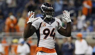 FILE - In this Sunday, Sept. 27, 2015 file photo, Denver Broncos outside linebacker DeMarcus Ware (94) warmups before an NFL football game against the Detroit Lions in Detroit. Police are investigating a burglary at the home of Denver Broncos outside linebacker DeMarcus Ware that occurred while he was at a football game with the Houston Texans on Monday, Oct. 24, 2016. (AP Photo/Duane Burleson, File)
