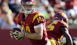 FILE - In this Saturday, Oct. 8, 2016, file photo, Southern California quarterback Sam Darnold looks to pass during the second half of an NCAA college football game against Colorado in Los Angeles.  The Trojans will attempt to build on their three-game winning streak Thursday night at the Coliseum against weary California, which had a short week to prepare for the Pac-12 showdown. (AP Photo/Jae C. Hong, File)
