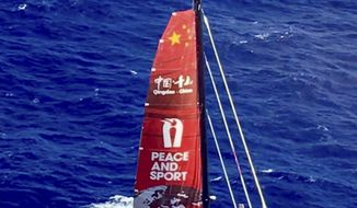 CORRECTS DATE OF PHOTO TO TUESDAY, OCT. 25, 2016 - This photo provided by the U.S. Coast Guard shows a trimaran that the U.S. Coast Guard has located in Hawaii on Tuesday, Oct. 25, 2016. Guo Chuan, a Chinese man attempting to set a sailing record from San Francisco to Shanghai, has been reported missing from the yacht. (U.S. Coast Guard/Air Station Barbers Point via AP)