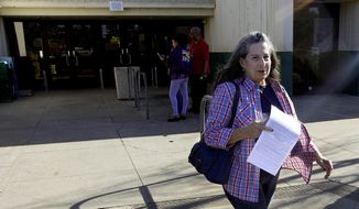 Grace Stratman leaves the Department of Motor Vehicles after she was unable to get her drivers license renewed due to a computer failure, in Carmichael, Calif., Wednesday, Oct. 26, 2016. The Department of Motor Vehicles says a catastrophic computer failure is hampering operations at more than 100 field offices. The outage began Monday affecting offices around the state. (AP Photo/Rich Pedroncelli)